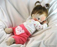 muñeco bebe tumbado