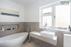 New life for a 1920s home - extension and full renovation, Thames Ditton, Surrey : Modern bathroom by TOTUS