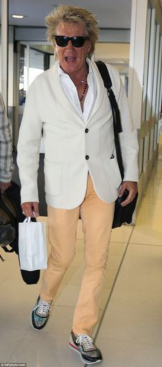 Snazzy: The chart-topper was pictured in a pair of colourful trainers to match his he continues to tour the southern hemisphere
