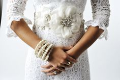 Swarovski pearl and crystal bangles and jewelry by Erica Koesler. Photography by Stephanie Baker for Bridal Couture Magazine