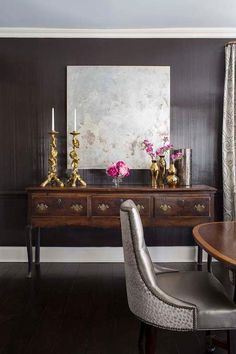 Glamorous Dining Room with Black Floors & Black Walls with Antique Cabinet with Gold Decor | Pimlico Interiors