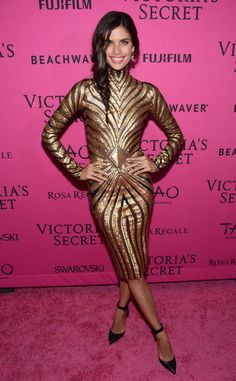 Sara Sampaio from 2015 Victoria's Secret Fashion Show After-Party  The Portugese stunner looked statuesque in a long-sleeved, knee-length gold dress.
