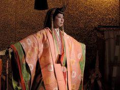 A woman wearing junihitoe dancing.