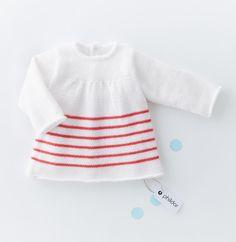 Voici un modèle de brassière pour égayer le dressing de bébé. Elle est réalisée en Laine SUPER BABY coloris cygne et groseille. L'esprit marin met le cap sur les couleurs et le bonheur ! Modèle n°20 du catalogue n°139, layette, printemps-été 2017