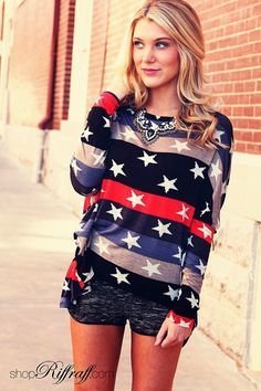 STARS & STRIPES Show your American pride with a fresh take on stars and stripes for fall. Our Stars and Stripes Flyaway top has fitted sleeves and a flowy body, flattering on all body shapes. We love this top paired with our Dolphin Cut Tweed Shorties and Black Leather Booties. Overall, these pieces create a very current and put together look. Shop this outfit today on www.shopriffraff.com.