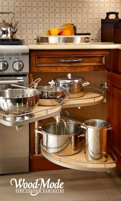 Le Mans pull-out for easy access to pots and pans hidden deep in a corner cabinet.
