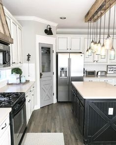 See this Instagram photo by @ourfauxfarmhouse • that amazing graphite colored kitchen island, gray pantry door Farmhouse Door, Farmhouse Cabinets, Farmhouse Kitchen Light Fixtures, White Farmhouse, Farmhouse Interior Doors, Barn Wood Cabinets, Farmhouse Kitchen Island, Kitchen Island Makeover, Farmhouse Layout