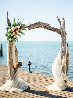 A driftwood arch is perfect for a waterfront wedding ceremony.