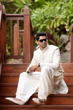 Dressed in white or off-white, this ensemble will inspire respect and is an outstanding look for the groom