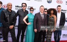 Musicians Mel Gaynor, Andrew Gillespie, Catherine Davies, Charlie Burchill, Jim Kerr, Sarah Brown, and Gerard Grimes of Simple Minds arrives at the 2015 Billboard Music Awards at MGM Garden Arena on May 17, 2015 in Las Vegas, Nevada.