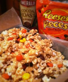 2 oz) bags of popped popcorn ½ cup unsalted butter ¾ cup brown sugar ½ teaspoon vanilla extract 2 cups of mini marshmallows (or about 20 large) ¼ cup creamy peanut butter 1 cup Reese's . Yummy Snacks, Delicious Desserts, Snack Recipes, Dessert Recipes, Cooking Recipes, Yummy Food, Popcorn Snacks, Flavored Popcorn, Popcorn Toppings