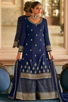 Sway away everyone with your simplicity as you wear this navy blue georgette sharara suit which will give you absolute perfection. This round neck and full sleeve party wear suit elaborated using zari and stone work. Set together with georgette sharara pants in navy blue color with navy blue georgette dupatta. Sharara pants has stone, zari and sequins work. Dupatta also adorned with zari and stone work. #shararasuits #malaysia #Indianwear #weddingwear #andaazfashion Indian Attire, Indian Wear, Pantalon Cigarette, Sharara Suit, Bollywood Dress, Modest Wear, Georgette Fabric, Festival Wear, Pakistani Suits