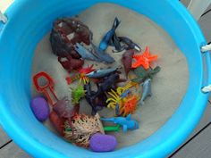 Mom's Tot School: Little Mermaid Birthday Party game! filled a bucket with play sand (about $3.50 a bag from Lowes!). And we hid 34 sea creature figures inside (purchased from Amazon.com). This game was a huge hit!