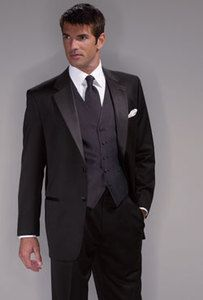 black suit with black vest and tie- possible father of bride/groom or groomsmen if groom wears red