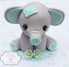 Fondant elephant cake topper.