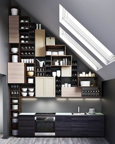 IKEA Sektion brown wood effect cabinet frames with TINGSRYD black wood effect doors, drawer fronts, BROKJULT light gray walnut effect doors, drawer fronts, BJORKET birch doors, MAXIMERA soft closing drawers and HORDA open cabinets: $999