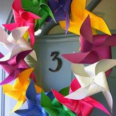 Loving my new front door wreath!   Find the tutorial here:  http://paper.tipjunkie.com/pinwheel-wreath-papercraft/?utm_source=feedburner_medium=feed_campaign=Feed%3A+TipJunkieAllSites+%28Tip+Junkie+%7E+Creative+Inspiration+%7BAll+Sites%7D%29_content=Google+Reader