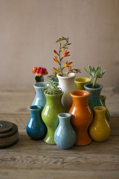 set of thirteen nesting multi-colored ceramic bud vases