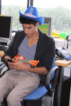 Siva from The Wanted makes himself comfy in the SPIN studio