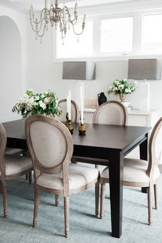 black dining table and neutral linen chairs