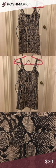 Snake-skin bandage going out dress size 4! Brand new snake-skin bandage dress great for a night out. Thin bandage material with spaghetti straps. From H&M. US size 4 or EUR size 34. 88% viscose, 10% polyamide and 2% elastane. H&M Dresses Mini