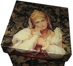 This box is covered with paper and then I decoupaged the image on the lid :)