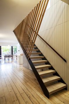 baker residence - stair going up-light from above filters through timber battens. By Designmas