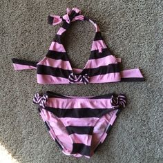"""Toddler Juicy Couture Beachbaby swim suit Toddler pink and brown Juicy Couture Beachbaby swimsuit. Bows on side of hips and in the top middle. """"JUICY"""" written on back. Great used condition no holes or rips Juicy Couture Swim Bikinis"""