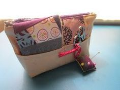 Too Cute Travel Sewing Bag - DIY organizer ideas are all the range right now; which is why they make such great small handmade quilt gifts. If you have a friend that is a quilter or sewist, make them this Too Cute Travel Sewing Bag for organizing all of their rotary cutters, needles, and scrap fabric while they're on the go. Sometimes it's hard knowing what to get a friend for Christmas, but this free quilted gift pattern is an unexpectedly thoughtful and useful idea.
