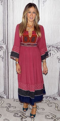 Sarah Jessica Parker brought her usual eccentrically cool sense of style to the AOL Build Series to discuss her new HBO series Divorce. She wore a pretty pink number with embroidery at the bodice and along the sleeves and hemlines, accessorizing with a stack of necklaces and glittery teal peep-toe heels.