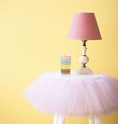 love this idea...a stool converted into a night stand by using a tutu...