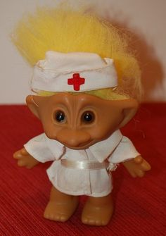 Troll Doll Unmarked- Nurse- 3 3/4 inches- Yellow Hair