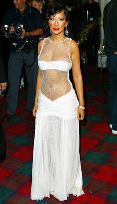 "Christina Aguilera's Body Evolution: November 6, 2003; The ""Beautiful"" singer flaunted her abs and ample cleavage in a revealing dress at the MTV Europe Music Awards."