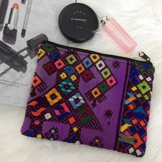 "Ketzali Textile Make-up Bag. Price firm. Ketzali ""Xubal Recycled Textile Make-up Bag. Each Ketzali bag is handmade in Guatemala with care and dedicated skill and is one of a kind! Size is 8"" L x 6.5"" H. Ketzali Bags Cosmetic Bags & Cases"