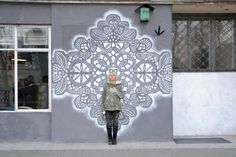 """Polish artist NeSpoon, whose artistic focus is to transfer patterns of lace to urban spaces. She calls her artistic approach the """"Jewellery of the urban space"""". NeSpoon often uses the usual spray paint and stencils of enlarged lace patterns to produce her works on the street. But she also makes lace installations for gallery art events or simply fill the blanks in urban areas with pottery.Via: www.joquz.com"""