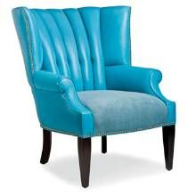 CHIC SEATHancock & Moore combines the Traditional sensibility of channel tufting with the Modern look of bold Tiffany-blue leather in its Proctor Wing Chair.