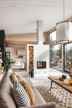 Jenni and Tero were set on having a log home. This was due to many factors: ecology, indoor air and, in particular, the pleasant appearance of a modern log house. The colour scheme is in harmony with the natural landscape seen from the windows. #Honkarakenne #Honkatribe #loghome #logcabin #loghomelife #loghomeliving #hirsitalo #hirsikoti #honka #cozy #relax #livingroom #nordicarchitecture #woodenhouse #modern #architecture #windows #interior #decor #livingroom #olohuone #takka #fireplace Modern Cabin Interior, Chalet Interior, Home Interior Design, Natural Modern Interior, Room Interior, Small Modern Home, Modern Tiny House, Small Wooden House, Log Home Interiors