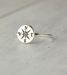 Silver compass ring. (Disclaimer: only points North if you make it do so. Do not get lost in the woods with this ring. That is all).