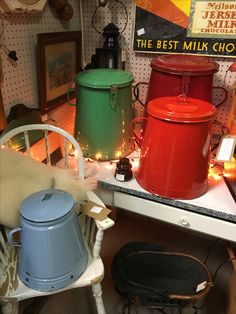 "I saw these vintage European enamel canisters at a local antique mall and I can't stop thinking about them. Largest is about 30"" tall."