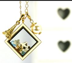 Beautiful vacation locket and new Eiffel Tower droplet