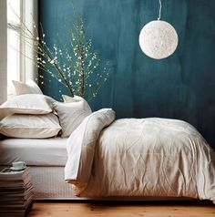 Minimalist Decor with Teal walls and a simple Chinese Ball Lamp Full Headboard, Teal Walls, Turquoise Bedroom Walls, Teal Bedroom Decor, Teal Wall Decor, Bedroom Flowers, Wall Flowers, Bright Walls, Tiny Flowers