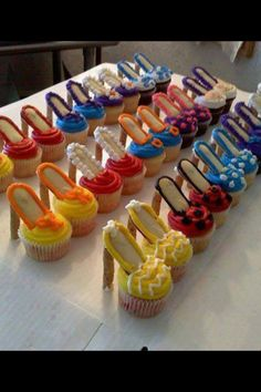 Adorable ladies shoe cupcakes for your best friends birthday or maybe a sweet 16...heels are made with pirouette cookies attached to Milano cookies and then trimmed out on a color to compliment the (cupcake!!) toe of the shoe !!