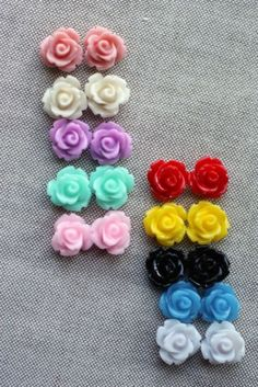 Tiny, Petite & Oh So Sweet - 70% off  at The Plaid Barn Two Choices Available:    Back to Basics     2 Red   2 Yellow  2 Black   2 Dark Blue   2 White                OR  Soft & Sweet     2 Ivory  2 Baby Pink  2 Salmon  2 Aquamarine  2 Violet  All small rose cabochons measure approx. 10mm and are made of resin.   Limit of 20 sets per order (mix & match).