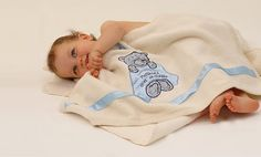 Blue Teddy   Blanket approx. 100x75cm. Teddy© applique approx. 30cm. Handmade in 100% cotton Liberty print with baby's first name, date and time of birth embroidered on 100% polyester satin shape with matching satin ribbon at each end of blanket.