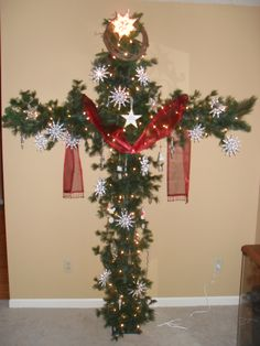 """Now that's my idea of a Christmas tree! A Cross Christmas tree. Made from PCV pipe and garland. Red sash symbolizes our sins and the snowflakes symbolize forgivess. Isaiah """"Those your sins be as scarlet,they shall be white as snow. Church Christmas Decorations, Christmas Tree Themes, Xmas Tree, Christmas Projects, Holiday Crafts, Christmas Wreaths, Christmas Ornaments, Christmas Ideas, Christmas Cross"""