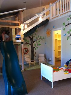 balcony, miniature seating, slides  swings, and fun color palette all included in this vaulted play room  uvparade 2012