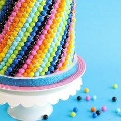 Sixlets cake - 5 layers with a birthday blue swirl inside.