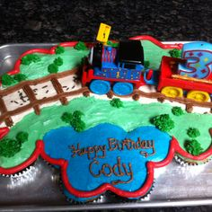 Thomas the Train Cupcake Cake....Sara, different!! I don't know how detailed they want to get. But this is cute!!