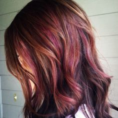 A more subtle purple hair with burgundy tones.