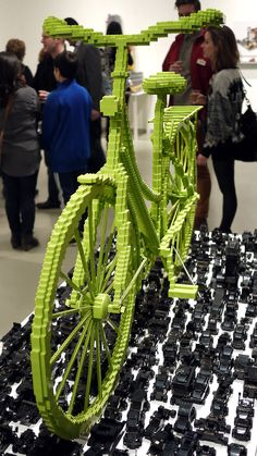 LEGO green bicycle Sean Kenney, photo by Michael Surtees . and I never noticed all the tiny black vehicles serving as pavement.
